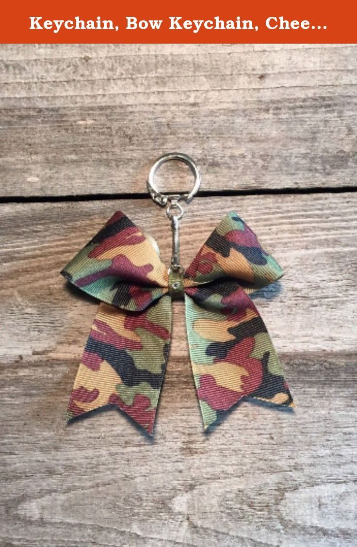 """Keychain, Bow Keychain, Cheer Bow Keychain. Camouflage cheer bow keychain. 1.5"""" grosgrain ribbon. Embellished with The Cheer Shack's signature rhinestone. Great for decorating backpacks, bags, etc. Print design and color on each bow may vary."""
