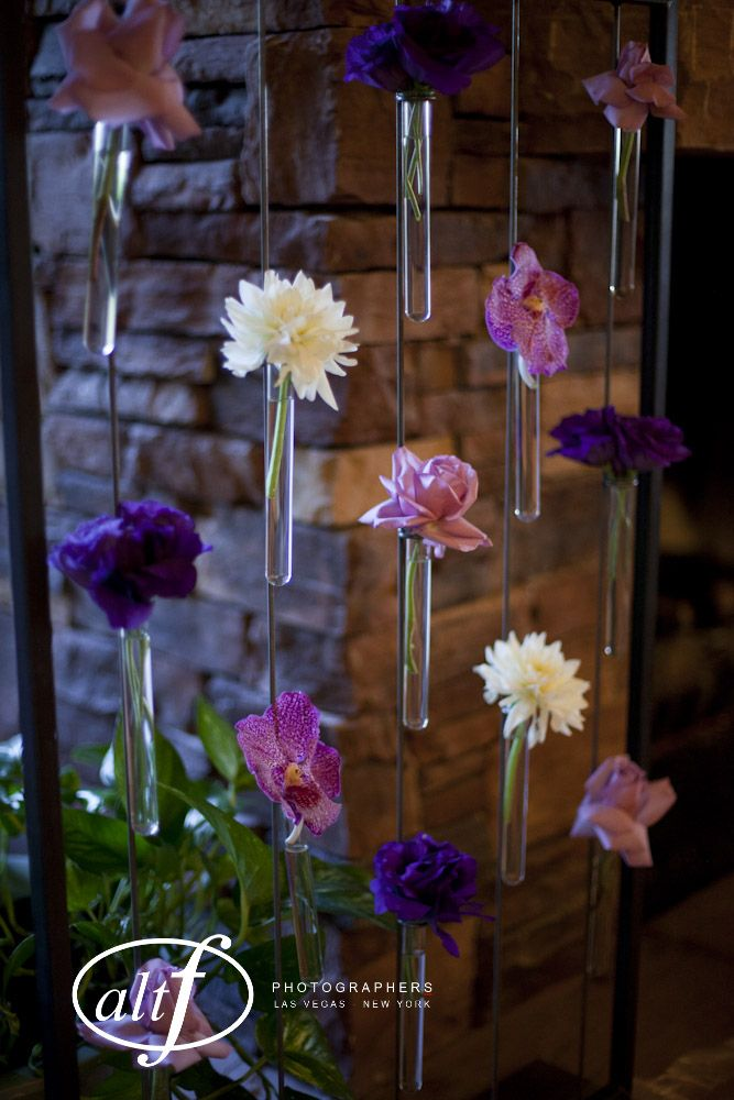 On each side of the fireplace: purple vanda orchids, lavender roses, white dahlias, and purple lisianthus in our test tube canvas piece. #naakitifloral