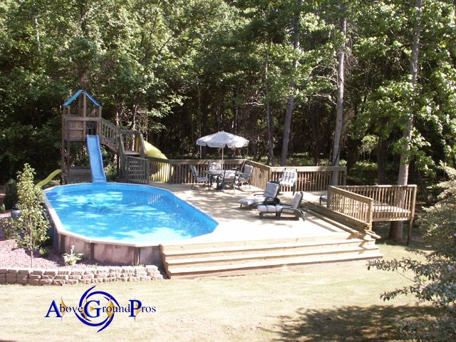 love everything about this above ground pool deck playset with slide into pool - Diy Above Ground Pool Slide