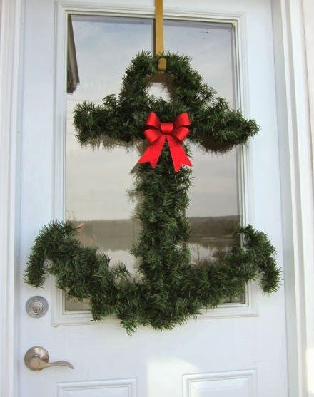 Creative Christmas anchor wreath with greenery. Christmas Front Doors with a Nautical and Coastal Theme.