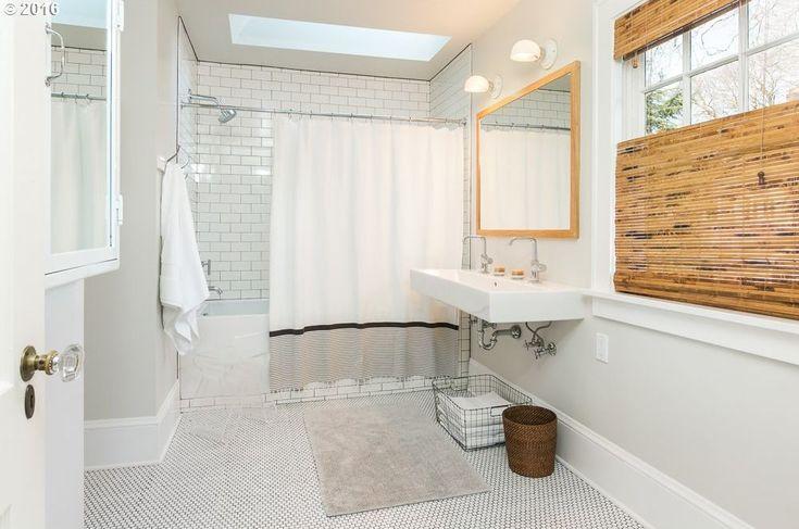 Traditional Full Bathroom with Skylight, penny tile floors, High ceiling, Rain Shower Head, Vero Bathroom Sink by Duravit