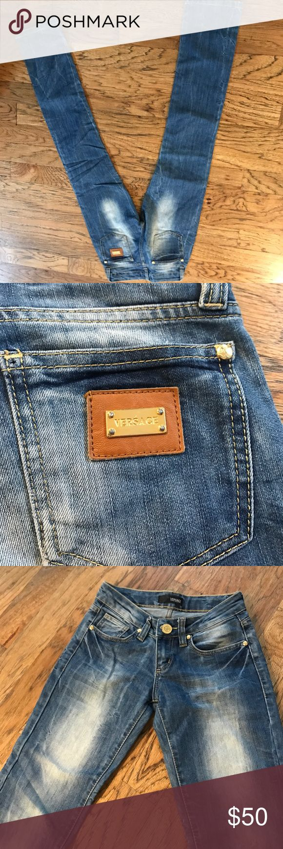 Versace jeans straight leg mid to low waisted Great condition Versace jeans medium wash no holes or tears. Size 26 European (I would say 0 in us). Versace Jeans Straight Leg