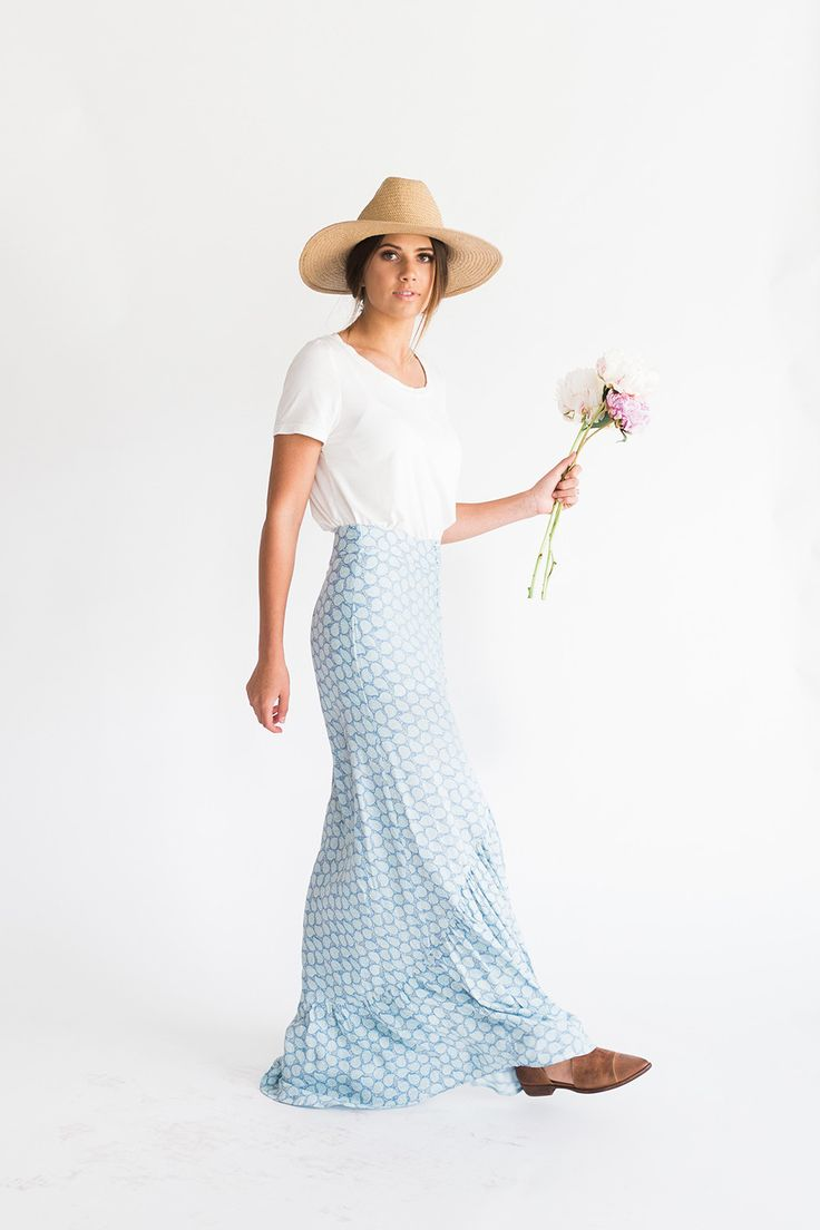 DETAILS: - Perfect summer maxi skirt! - Front slit with buttons - 100% rayon - Model is wearing a small (model is 5'7)