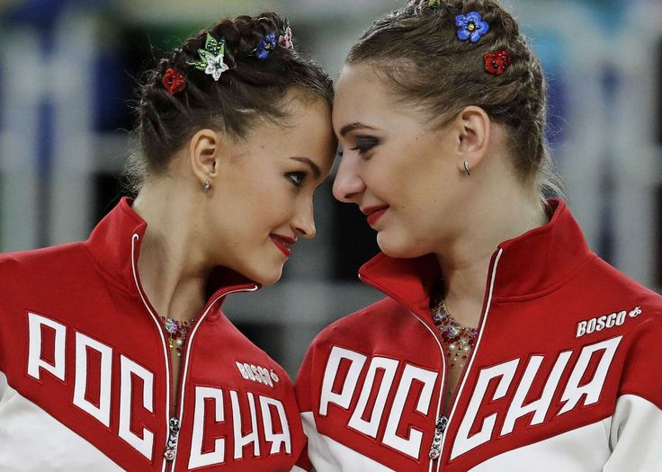 © Rebecca Blackwell/AP Touching moment:   Members of team Russia celebrate their gold during the rhythmic gymnastics group all-around final on Aug. 21.