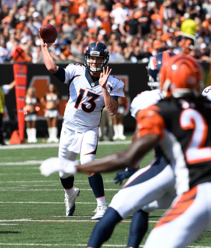 Denver Broncos quarterback Trevor Siemian (13) throws a pass to Demaryius Thomas during the first quarter against the Cincinnati Bengals September 25, 2016 at Paul Brown Stadium. John Leyba, The Denver Post
