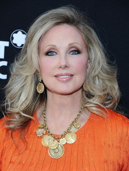 Morgan Fairchild – age 62, she would look better with a warmer, golder blonde haircolor. She's picked a shade that's too ashen.