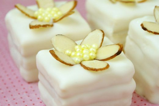 These petit fours are so easy, and the sliced almond and sprinkle flowers are adorable