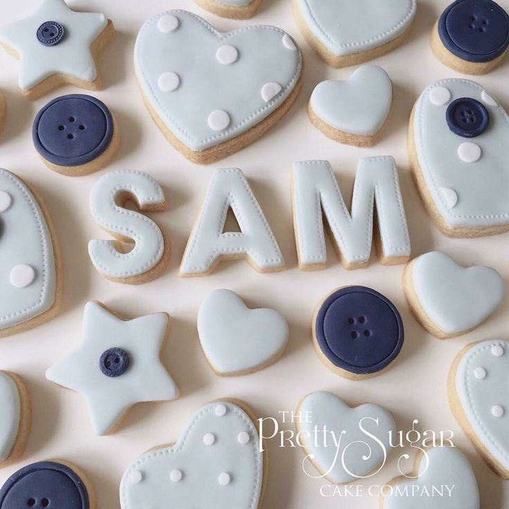 New baby name cookies in baby blue and navy with polka dot and buttons detail