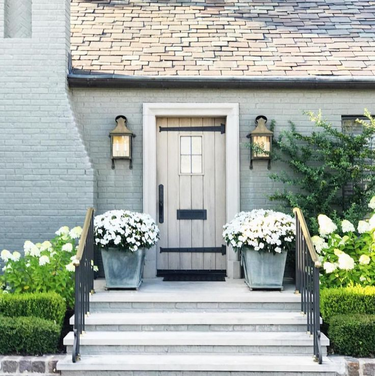 pretty paint color combination. we'd have a natural shingle (door color) and the blue grey as the door color, windows/trims