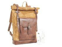 Sandy waxed canvas rucksack. Brown leather pocket.