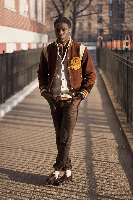 jkissi of street label in varsity jacket
