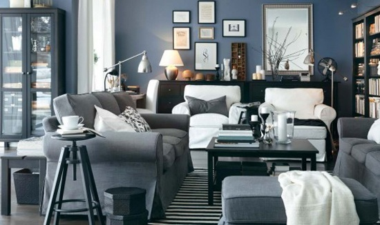 grey couch, white chairs, black tables and accent furniture, black/white striped rug, stone blue wall