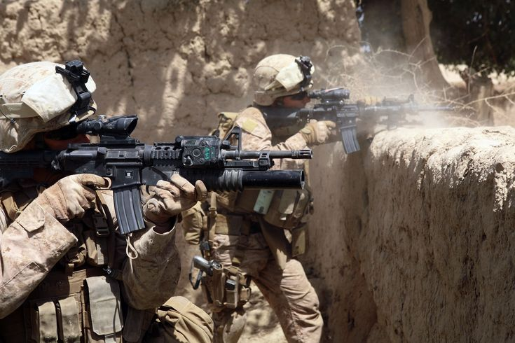 U.S. Marine Corps Sgt. Ryan Pettit (left) and Cpl. Matthew Miller with 2nd Battalion, 8th Marine Regiment fire their service rifles during an operation in the Helmand province of Afghanistan on July 3, 2009.  The Marines are part of the ground combat element of Regiment Combat Team 3, 2nd Marine Expeditionary Brigade.   DoD photo by Sgt. Pete Thibodeau, U.S. Marine Corps.  (Released)