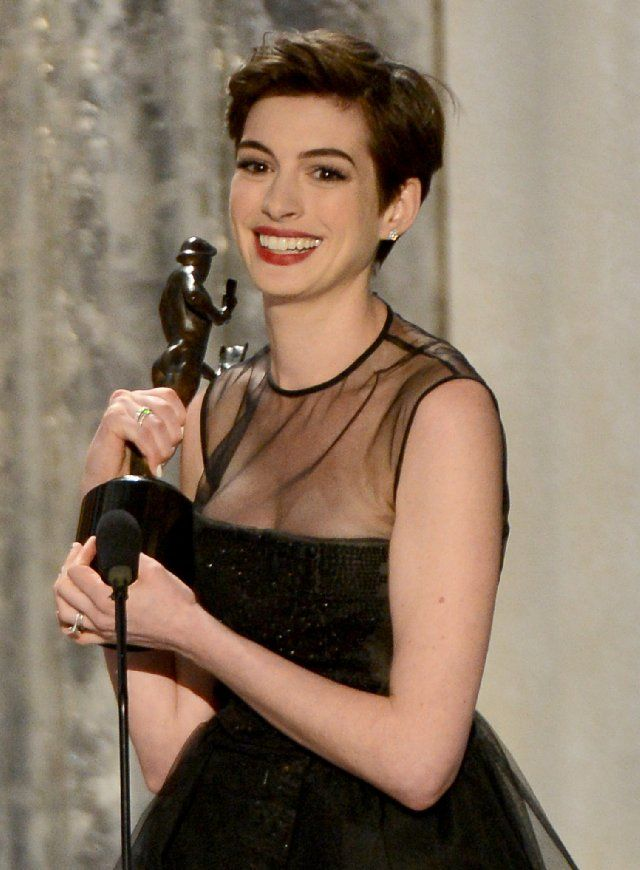 Anne Hatheway accepts the awards for Outstanding Performance by a Female Actor in a Supporting Role at the SAGs