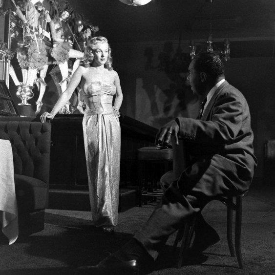 """Vintage Black Glamour  Composer, arranger and vocal coach Phil Moore giving singing lessons to a 22-year-old Marilyn Monroe at the legendary West Hollywood nightclub, the Mocambo, in 1949. Ms. Monroe was quoted in Ebony magazine in 1960 as saying, """"I will always be grateful to Phil Moore for his patience... he gave me confidence in my own vocal ability and made me realize that people would be willing to listen to me as well as look at me."""" Photo: J.R. Eyerman - Time & Life Pictures/Getty…"""
