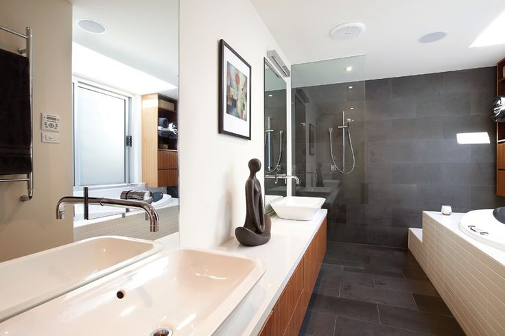 Balwyn House - exceptional ensuite bathroom - with natural overhead light, spacious, quality interior - view from bath over planned, private backyard lap-pool which can be stepped out into directly from the bathroom!