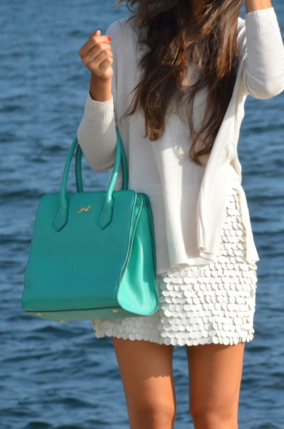 High waisted lace skirt, baggy white long sleeve, color pop bag.
