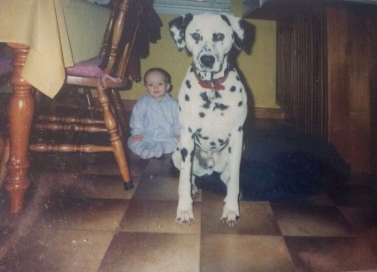 Sam sitting with me when I was a baby
