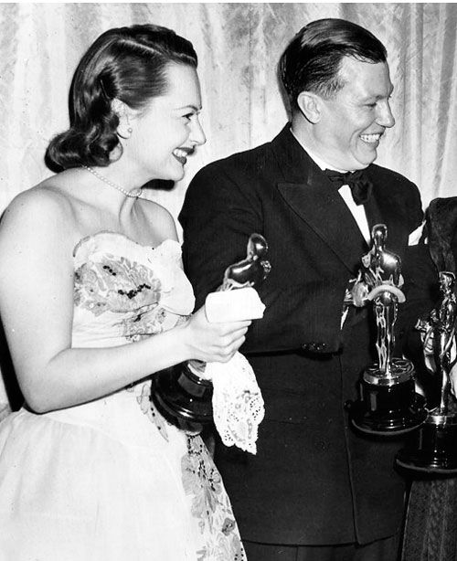 """Olivia de Havilland and Harold Russell with their Oscars at the 19th Academy Awards, March 1947. Russell is the only person in the history of the Academy Awards to receive two Oscars for the same performance.  He received one for Best Supporting Actor for """"The Best Year of Our Lives"""" 1946 and an Honorary Award for his service to the Nation.  Olivia won the Best Actress award for """"To Each His Own"""" 1946."""