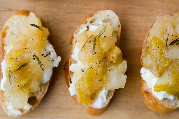 Pear and Rosemary Crostini With Goat Cheese    For the jam:  4 ripe pears, such as Bartlett, cored and diced  2 sprigs fresh rosemary  juice of 1 lemon  1/2 cup sugar  1/2 cup water    For the crostini:  1 baguette, thinly sliced into 1/4 inch rounds  6 ounces mild, creamy goat cheese  Cracked black pepper