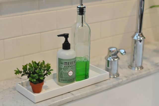 Decant your dish soap into a pretty glass bottle (like an olive oil cruet) and pair it with a touch of faux greenery. Megan at Honey We're Home gave her kitchen sink this fresh new look—and made dish-washing duty a little more pleasant.  - WomansDay.com