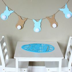 This bunny garland is too cute and easy not to make for Easter! Simple enough for kids to do.