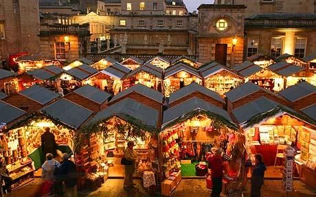 Christmas shoppers browse the stalls at the opening of the traditional Christmas market in Bath...I must go to this market next month!