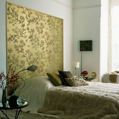 If an Asian screen headboard doesn't work out, maybe framed wallpaper (like this) would work instead.