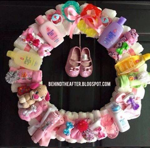 Make a wreath from useful baby items for a baby shower gift