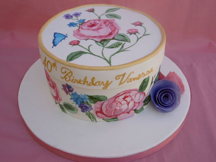 Vintage Hat Box Cake with hand painted flower design and wafer paper flowers.