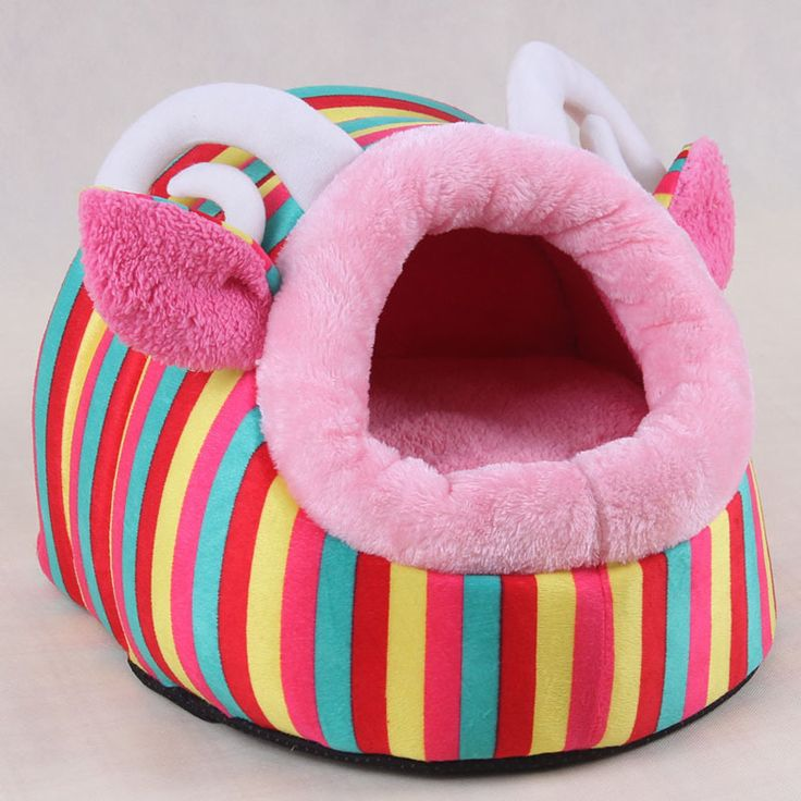 This colourful dog bed with ears is super soft and cosy. Using high quality materials this dog bed also includes a removable dog bed insert for easy washing or travelling.  Available in sizes small, medium and large.  Free Worldwide Delivery