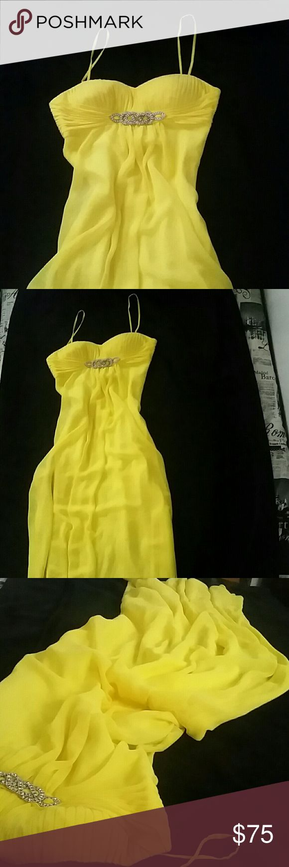 Gorgeous Yellow Dress formal This is such a pretty yellow dress for any dance or formal event. It has a silver, sparkly, feature under the cups and drapes down nicely from delicate straps. There is a small unnoticeable snag near the bottom, please ask for pictures if interested. Worn once, size 4. Original price was a good guess, as I do not remember correctly. Perfect for anything! Size 4 Cache, zip side.  Ask questions and make offers. Cache Dresses Prom