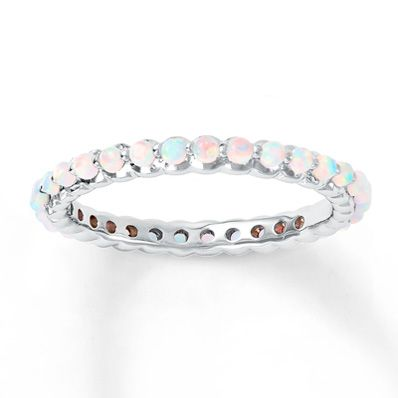 This eternity style stackable band is crafted of sterling silver with pretty lab-created opals. The band is 2.5mm wide.