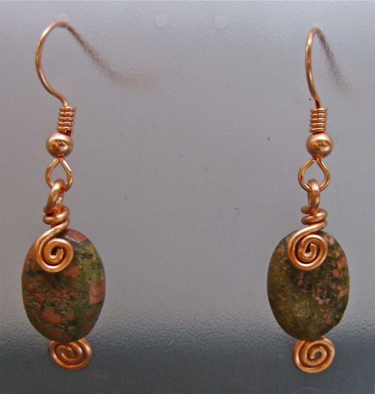 Unachite stones with copper wire wrapping...made as a set with the pendant