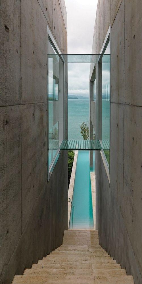 Nice contrast of materials – Glass bridge between concrete walls