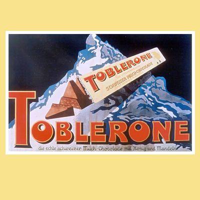 Emailleschild Der Plakatkünstler Emil Cardinaux schafft in den 1920er-Jahren das berühmteste TOBLERONE-Berg-Motiv: Ein überdimensionales (2.5m x 1.8m) grosses Emailleschild zeigt eine geöffnete TOBLERONE, welche vor dem Matterhorn schwebt.