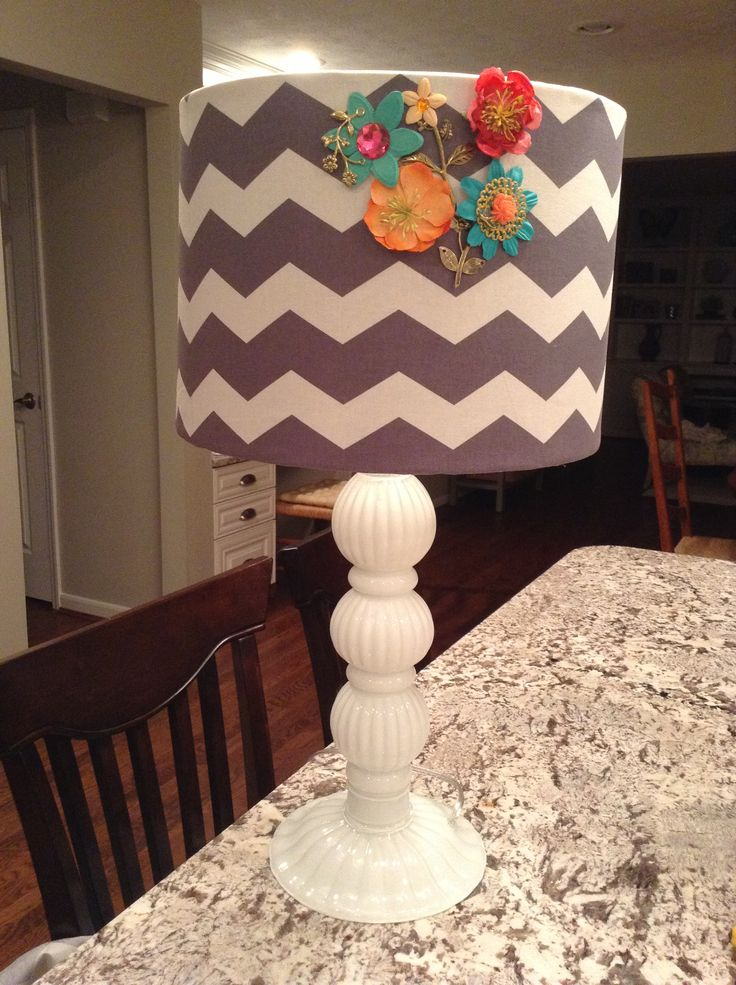 Recovering a lamp shade is super easy! Fabric and flowers from hobby lobby, lamp and shade from home goods!