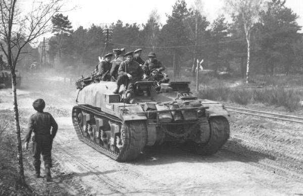 Soldiers of The Argyll and Sutherland Highlanders of Canada aboard a Kangaroo armored personnel carrier converted from a Ram tank, Europe, 11 Apr 1945