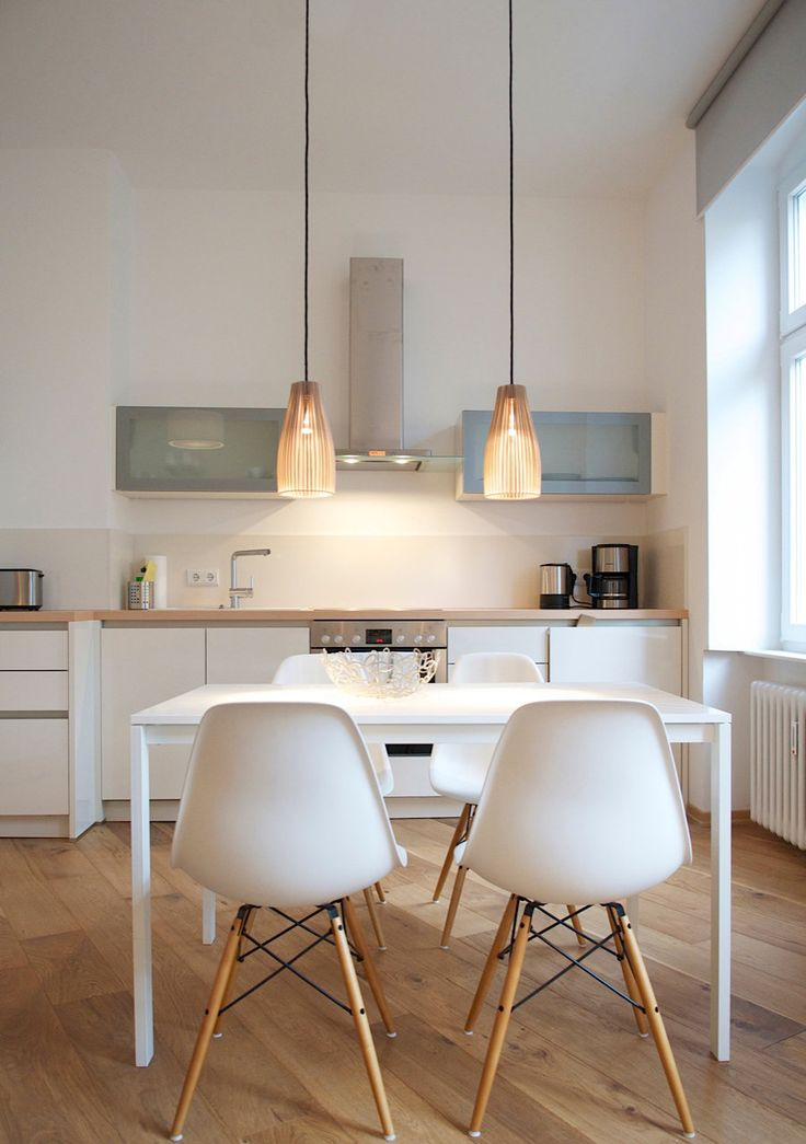 white and wood kitchen and dining table with eames chairs plus Ena - wooden hanging lamp