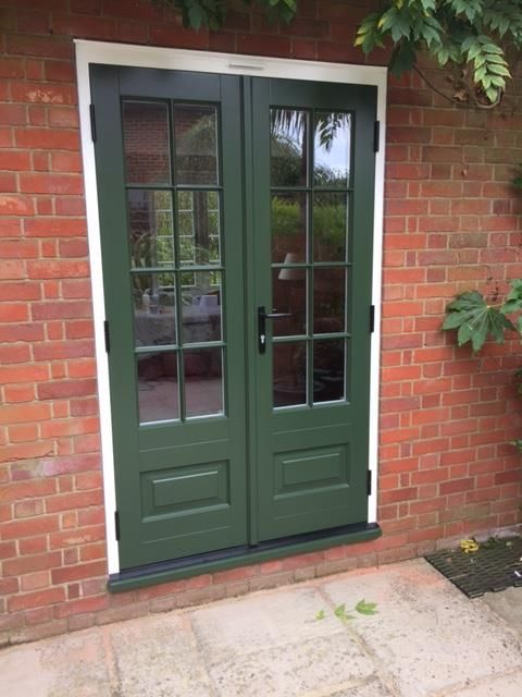 Bardwell timber French door with an off white frame and Fortnum sash & cill featuring astragal bars.