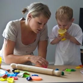 How does a speech therapist teach a child with autism?