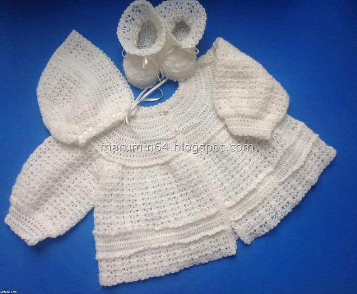 """Romantic, vintage look round yoke baby matinee jacket, with full sleeves. The yoke can easily be embellished with embroidery if desired. Three pearl buttons complete the """"antique"""" look of the garment. Matching booties and cap bonnet patterns are available for purchase."""