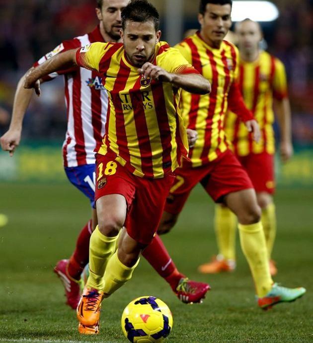 GRA262. MADRID, 11/01/2014.- El defensa del FC Barcelona Jordi Alba corre a por un balón durante el partido frente al Atlético de Madrid,cor...