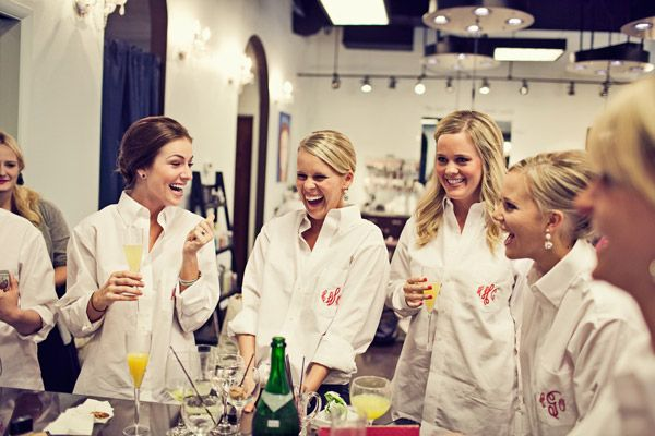 Fun photo idea: Wear customized, white button-downs while prepping for the big day!
