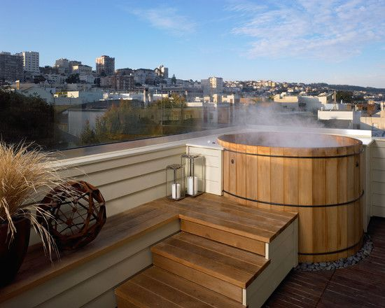 Exterior Design, Stunning Decks With Hot Tubs With Contemporary Rooftop Design And Wooden Stairs Also White Fence And Rocks Floor Featuring Pot Plant And City View: Spend Family Time in Decks with Hot Tubs