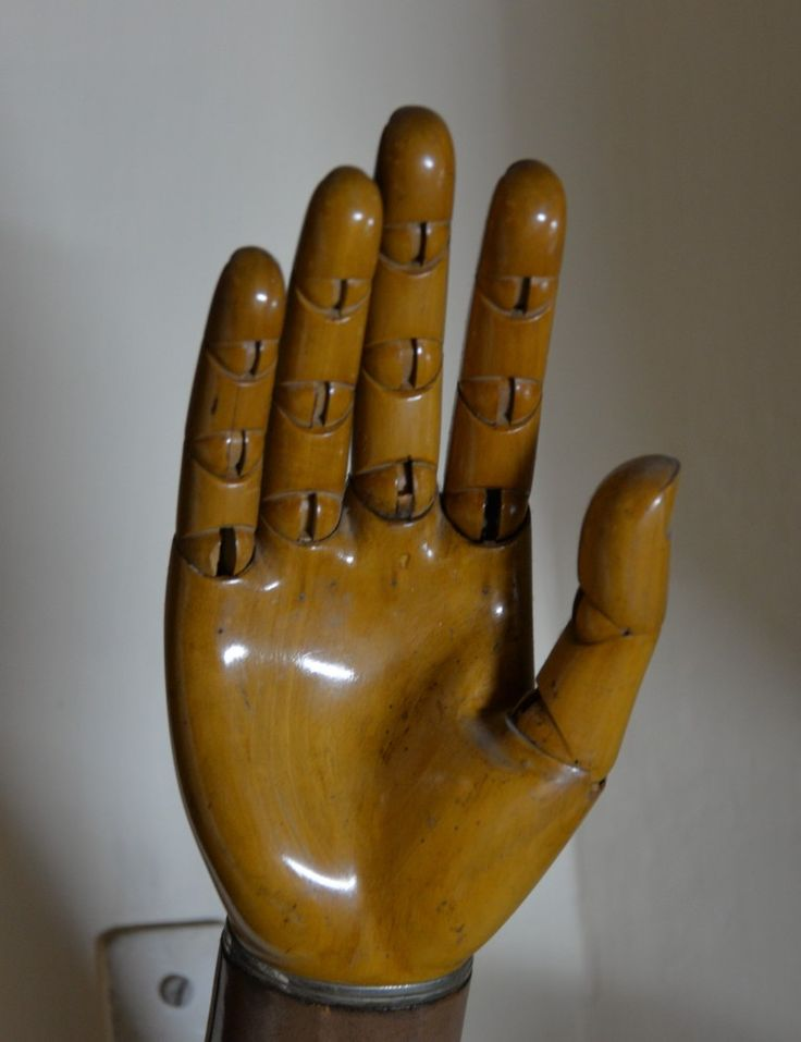 Artificial hand made entirely of finished wood with mobile hinge joints. Circa 19th century. Discovered from a hidden chest of an old house.