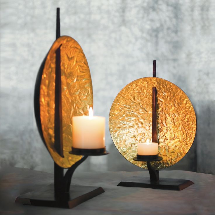 Gold sun disc candleholders in textured bronze and gold leaf