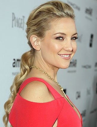 Wavy texture and plenty of height at the crown make Kate Hudson's ponytail party-ready. Wrap a strand of hair around the elastic for a final, dressed up touch.