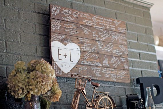 Reclaimed wood finds new life in this unique wedding guestbook sign. Each wood sign is fashioned from old pallets and hand-painted with an offset