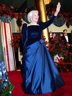 BARBARA BUSH, known for her triple strand of pearls and snow white hair.
